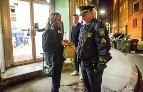 Michelle Fleming, 21, of Boston spoke casually with Sergeant James Earle as he stood outside Bova's Bakery at 2 a.m.